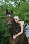 woman rides Thuringian warmblood