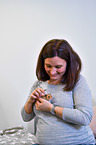 woman with Golden Hamster